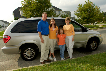 Family in front of minivan